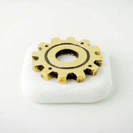 Cogwheel Paperweight on Marble